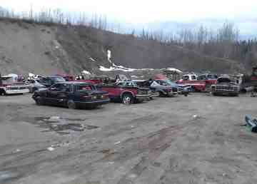 Old vehicles sit in a gravel pit at the southern end of Fort Liard