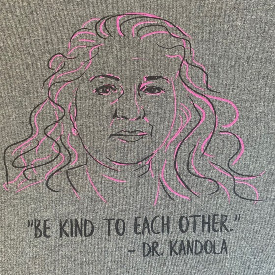 Dr Kami Kandola's face is seen next to one of her quotes on a t-shirt