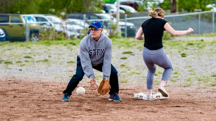 Gerard Landry playing baseball for a team of teachers against students in 2019
