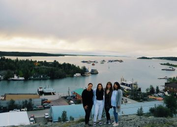 L-R: Christina Moore, Kalina Newmark, Xina Cowan, and Mahalia Yakeleya-Newmark from the Strong People, Strong Communities mural project on top of Yellowknife's Pilots' monument