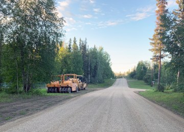 Work is under way to chipseal a portion of Tsetso Trail after the village and territorial government agreed to having the work done between the two entrances to Cazon Crescent
