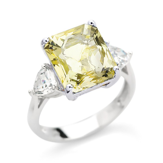 Our Stunning COCO ring is a Princess Cut Octagon Canary Simulant Stone 12×10 surrounded by 5x 5 Trilliant Diamond Simulant set in Sterling Silver Rhodium Plated in White Gold.