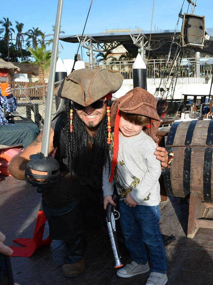 cabo legend sunset cruise in cabo san lucas boy with a pirate activities for kids in cabo, pirate snorkeling tour