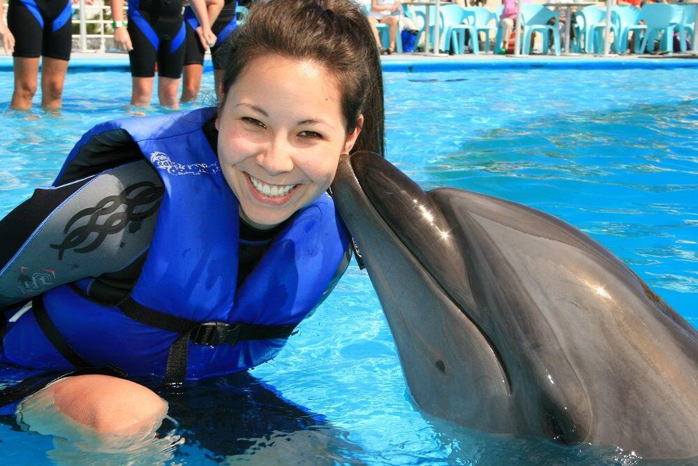 get kissed by a dolphin during the dolphin encounters cabo tour, cabo adventures