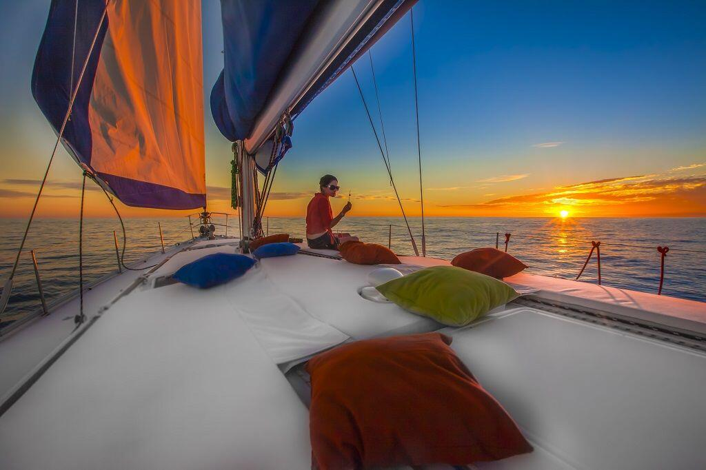 Sky turns orange watching the sunset aboard the luxury sunset sail in cabo san lucas cabo adventures