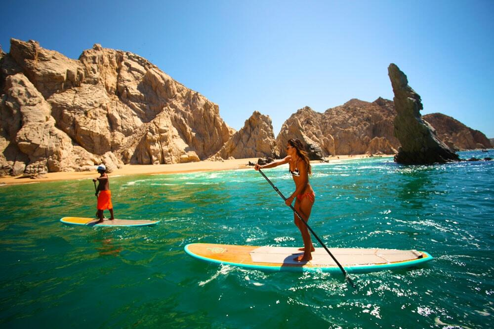 stand up paddle surfing near arch hot chick Cabo SUP