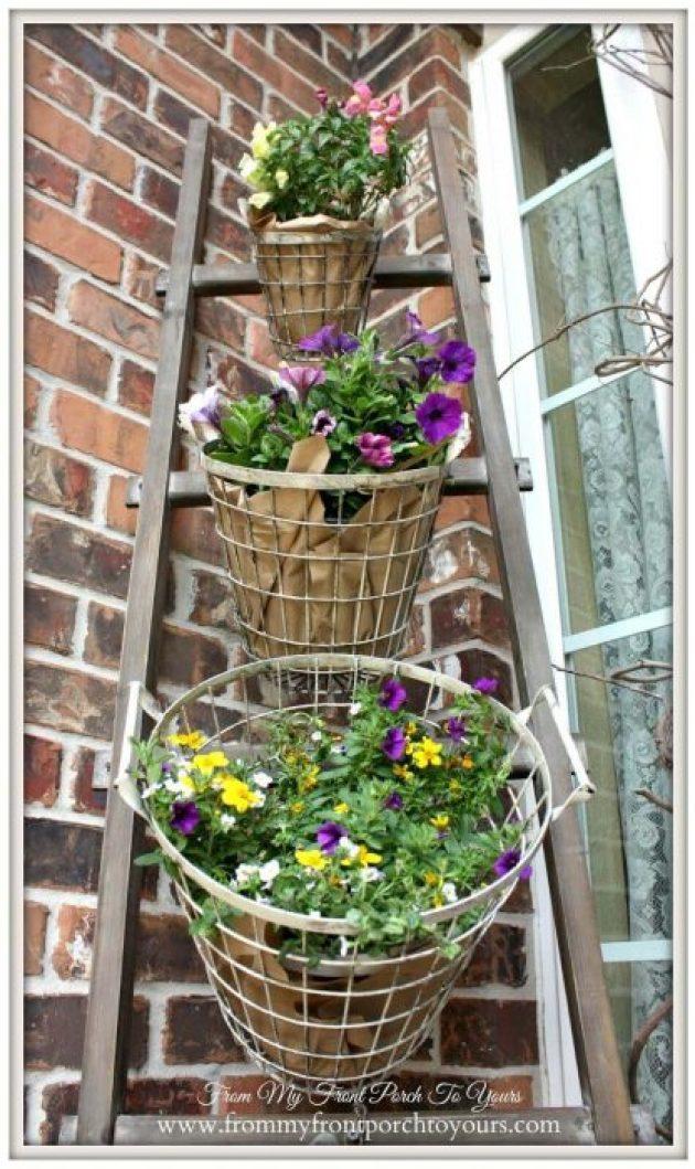 Farmhouse Porch Decorating Ideas - DIY Tiered Wired Egg Basket Planter Display - Cabritonyc.com