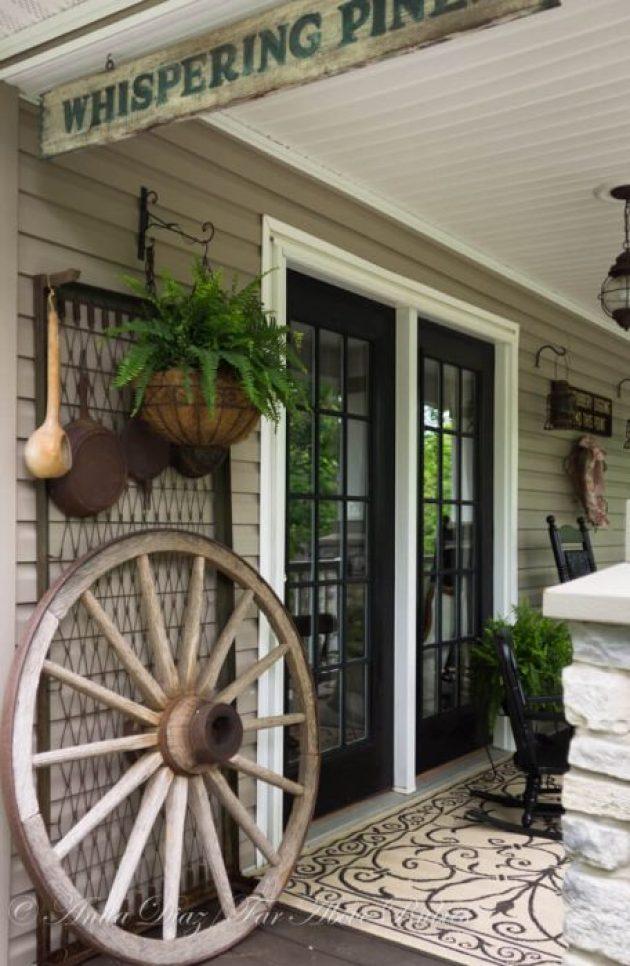 Farmhouse Porch Decorating Ideas - Go West Wagon Wheel & Assorted Hanging Pots - Cabritonyc.com