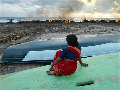 woman mourns dead after tsunami