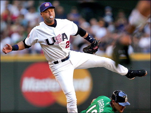 Team USA shortstop Derek Jeter blew a bubble after throwing to first for a double play while forcing out Mexico's Luis Alfonso Garcia. Team USA won 2-0 on Tuesday.