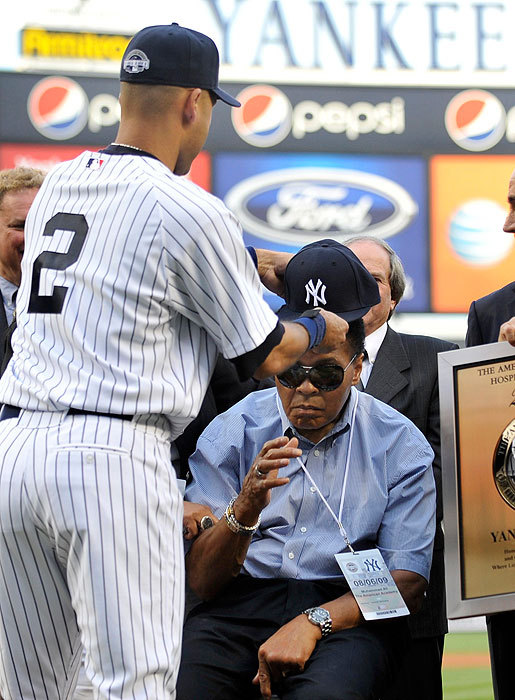 Jeter gave boxing great Muhammad Ali a New York Yankees cap before the game.