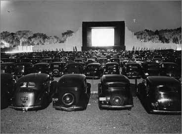 The world's first drive-in, in Camden, NJ, opened on June 6, 1933. Theaters cropped up all over the country. Pictured: Movie-watchers crowd the Weymouth Drive-In in the early 1940s.