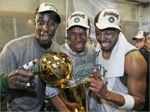 Kevin Garnett (left), Ray Allen (center), and Paul Pierce (right) celebrated in the Celtics locker room after their NBA championship victory.