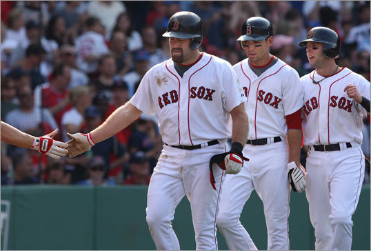 (Left to right) Kevin Youkilis, Jacoby Ellsbury, and Dustin Pedroia all scored on Youkilis' three-run home run in the seventh.