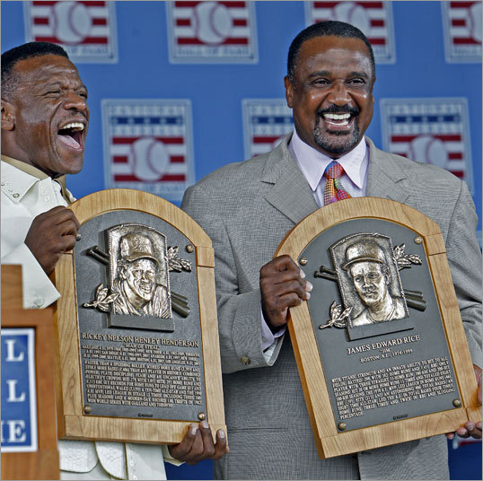 Rickey Henderson (left) and Jim Rice posed with their Hall of Fame plaques.