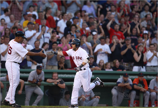 Dustin Pedroia brought the Fenway fans to their feet early when he belted a two-run homer, driving in Jacoby Ellsbury in the first inning.