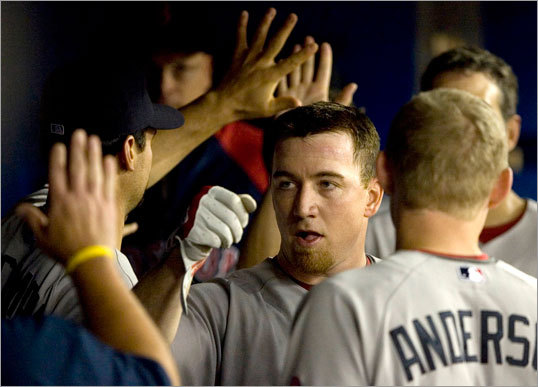 J.D. Drew was congratulated in the Red Sox dugout. He had four hits on the day.