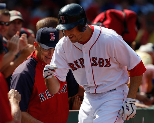 Rocco Baldelli was congratulated in the Red Sox dugout after his solo home run in the second inning.
