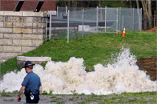 Water surged from the ground at the site of the leak in Weston.