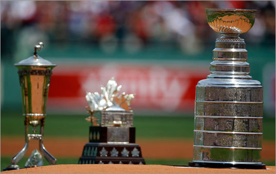 (Left to right) The Prince of Wales Trophy, the Conn Smythe Trophy, and the Stanley Cup -- all won by Bruins this postseason -- sat on the mound at Fenway Park.