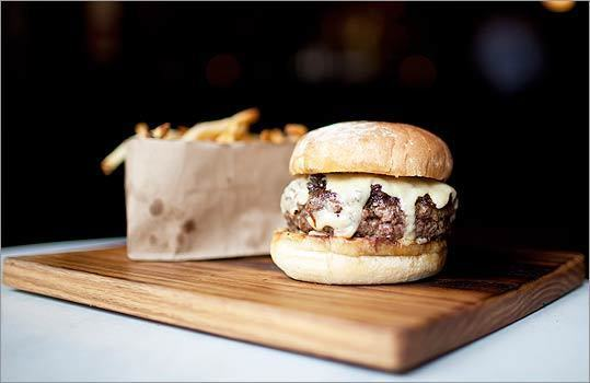 """5. BACK BAY SOCIAL CLUB A 10-ounce patty made from dry-aged prime rib, short rib, flank, and skirt, topped with """"smothered'' onions and cheddar. A price tag of $21 for a burger? Yeah, it's crazy. But as chef Timothy Raines says, """"It eats like a steak.'' Maybe you could just think of it as one. 867 Boylston St., Boston. 617-247-3200. www.backbaysocialclub.com . $21. — Devra First ( Read the full Globe article )"""