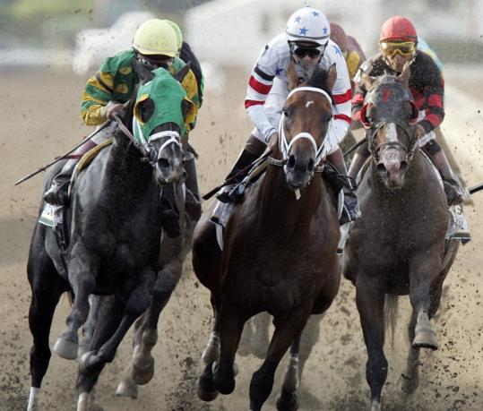 Big Brown squeezes between Atoned (left) and Magical Forest (right) around the first turn in the Haskell. photo by mel evans/AP/bostonglobe.com