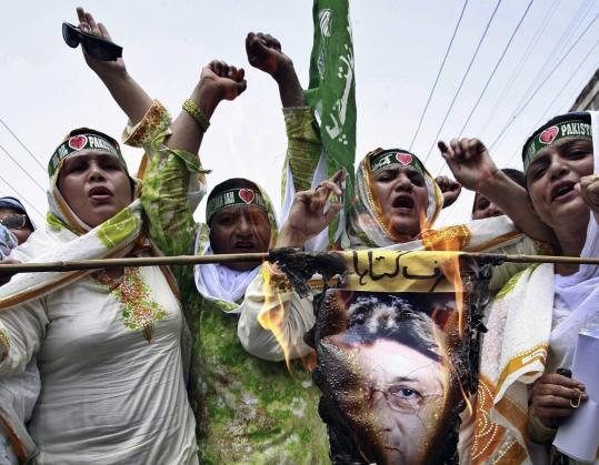 Asim Tanveer/ReutersSupporters of the Pakistan Muslim League burned a picture of President Pervez Musharraf as they chanted slogans against him yesterday in Multan. Musharraf called for political stability and reconciliation to tackle economic and security problems.