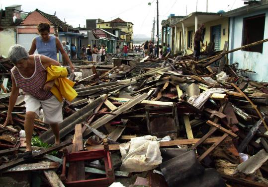 People made their way over rubble left on the streets yesterday by Hurricane Ike in Baracoa, Cuba. The storm slowed and weakened as it moved slightly offshore but was forecast to hit Havana early today with renewed vigor