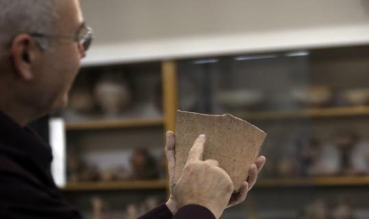 Ronen Zvulun/ReutersArcheologist Yossi Garfinkel held a shard of pottery containing writing at Hebrew University in Jerusalem.