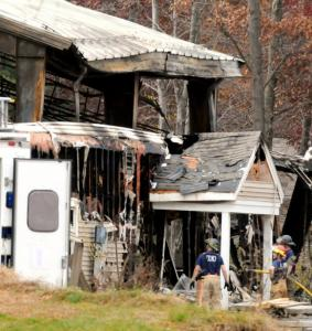 Firefighters worked to prevent the blaze in Springfield from spreading to houses.