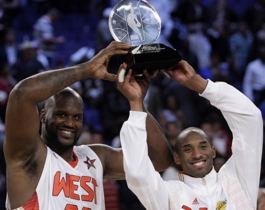 Just like old times, West teammates Shaquille O'Neal (left) and Kobe Bryant hoist some hardware - the Most Valuable Player trophy.