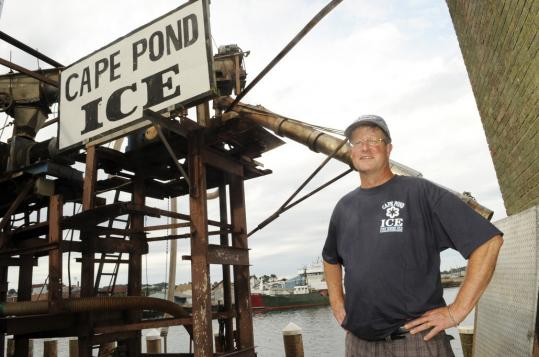 Scott Memhard of Cape Pond Ice has seen his harbor business drop by more than half.