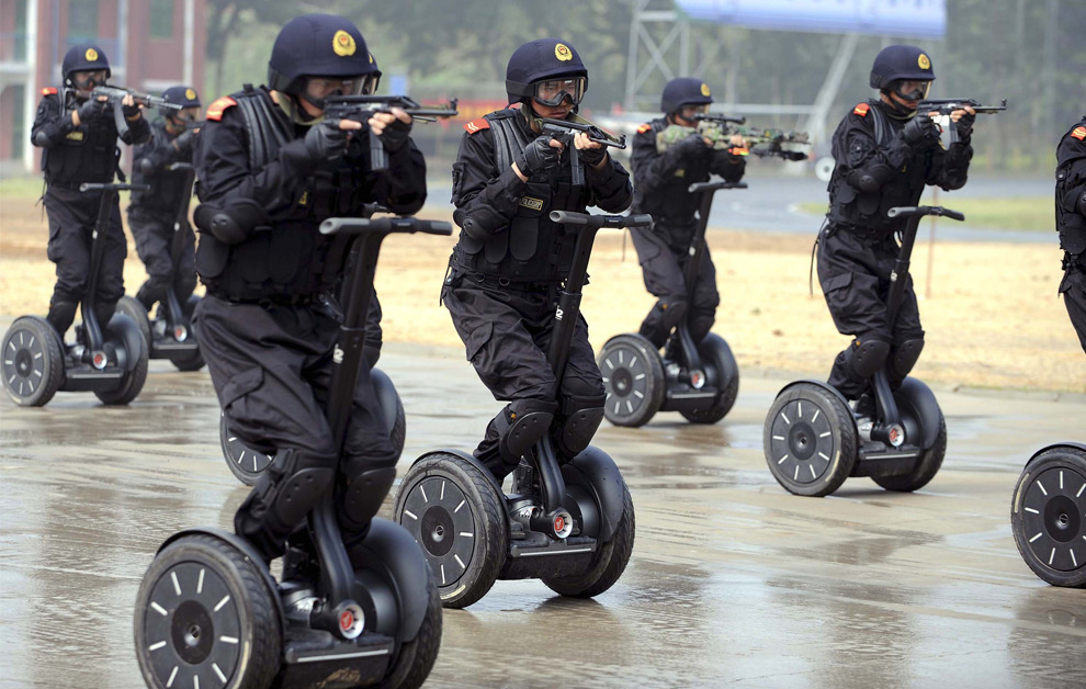 In this photo released by the official Xinhua news agency, members of Chinas armed police demonstrate a rapid deployment during an anti-terrorist drill held in Jinan, east China, on Wednesday July 2, 2008, roughly one month ahead of the Beijing Olympic Games. (AP Photo/Xinhua/Fan Changguo) #