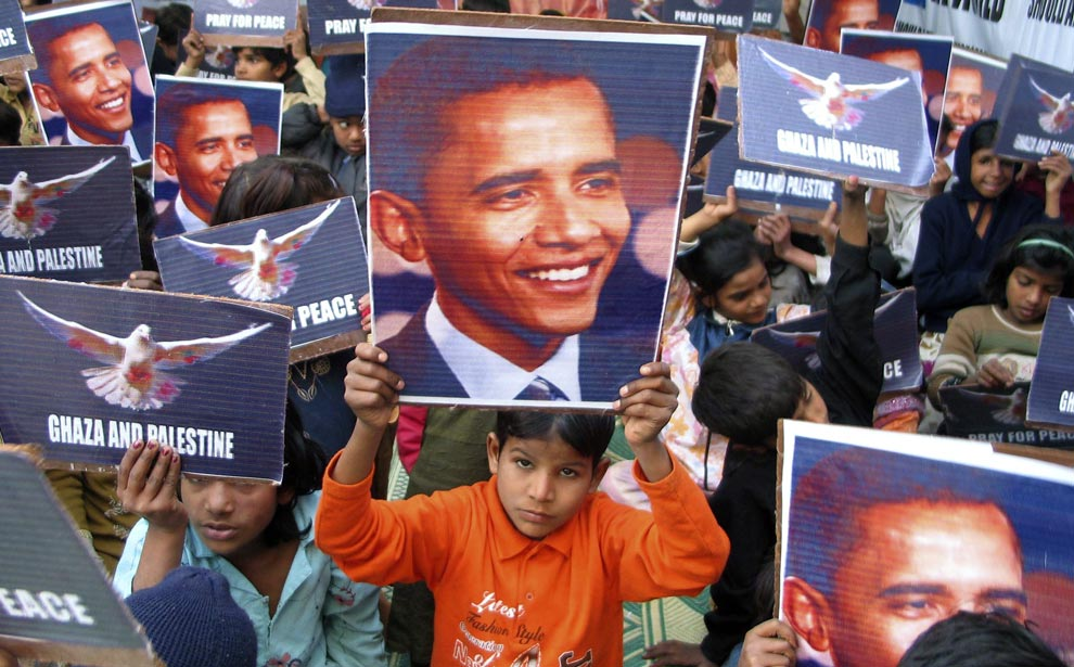 Pakistani Christian children hold portraits of U.S. President-elect Barack Obama during a prayers ceremony for global peace in Islamabad, Pakistan on Tuesday, Jan. 20, 2009. (AP Photo) #