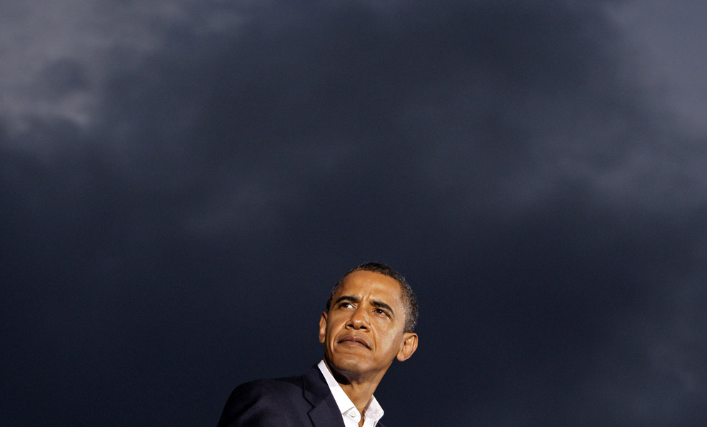 Democratic presidential candidate Sen. Barack Obama listens as storm clouds gather, while he is introduced by Democratic vice presidential candidate Sen. Joe Biden at a rally at the University of Mary Washington in Fredericksburg, Va. Saturday, Sept. 27, 2008.