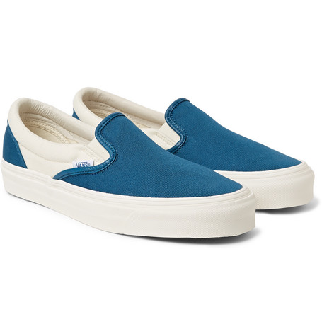 $60 - Vans' slip-on sneakers are the epitome of effortless cool. Referencing classic styles from the '70s, they're made from hard-wearing cobalt-blue and white canvas and set on substantial waffled rubber soles. Wear them with everything from chino shorts to tapered sweats. Shown here with Blue Blue Japan jacket, A.P.C. sweatshirt, Jean Shop jeans, Eastpak backpack.