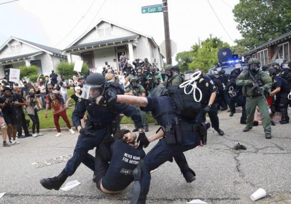 Police arrested dozens of more protesters in Baton Rouge ...