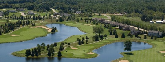 Team Hotel Green Bay   Radisson Hotel   Sports Teams Aerial view of greens  lakes and houses on the Thornberry Creek golf course