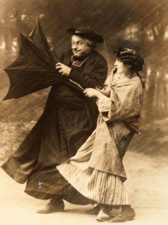 https://i1.wp.com/cache2.artprintimages.com/p/LRG/29/2955/NJPRD00Z/art-print/elderly-priest-and-young-woman-trying-to-hold-on-to-an-umbrella-turned-inside-out-by-a-gust-of-wind.jpg