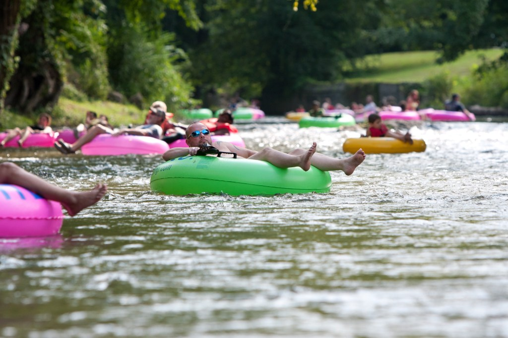 people floating down a river in inner tubes