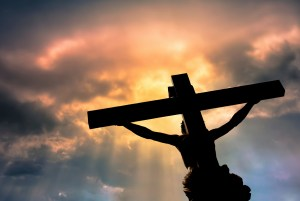Jesus Christ Son of God over dramatic sky background