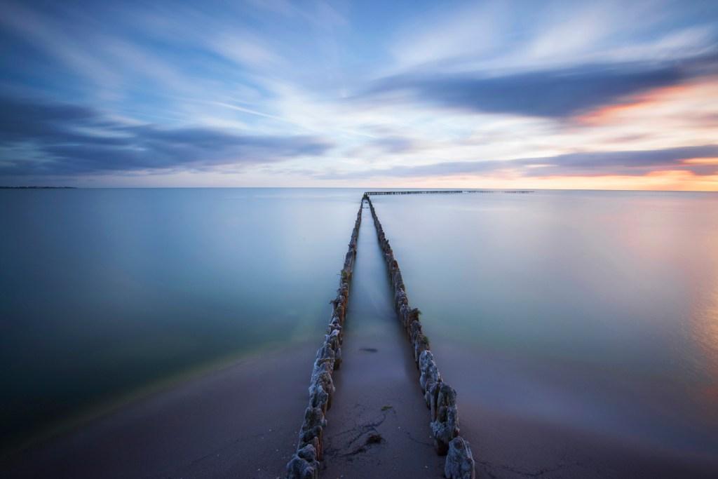 breakwaters lead to the horizon into infinity.