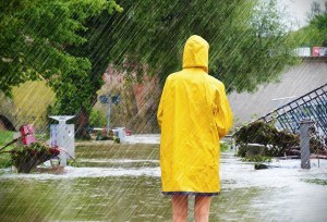 Woman standing in a flooded street
