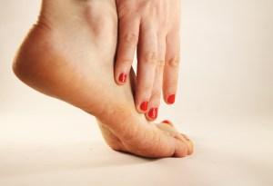 hand touching foot