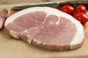 Raw steak on a wooden board