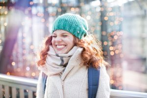 woman expressing delight in winter scene