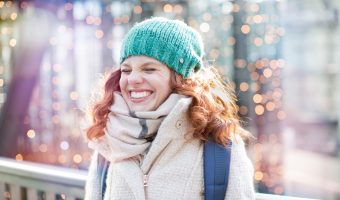 woman expressing delight in winter scene