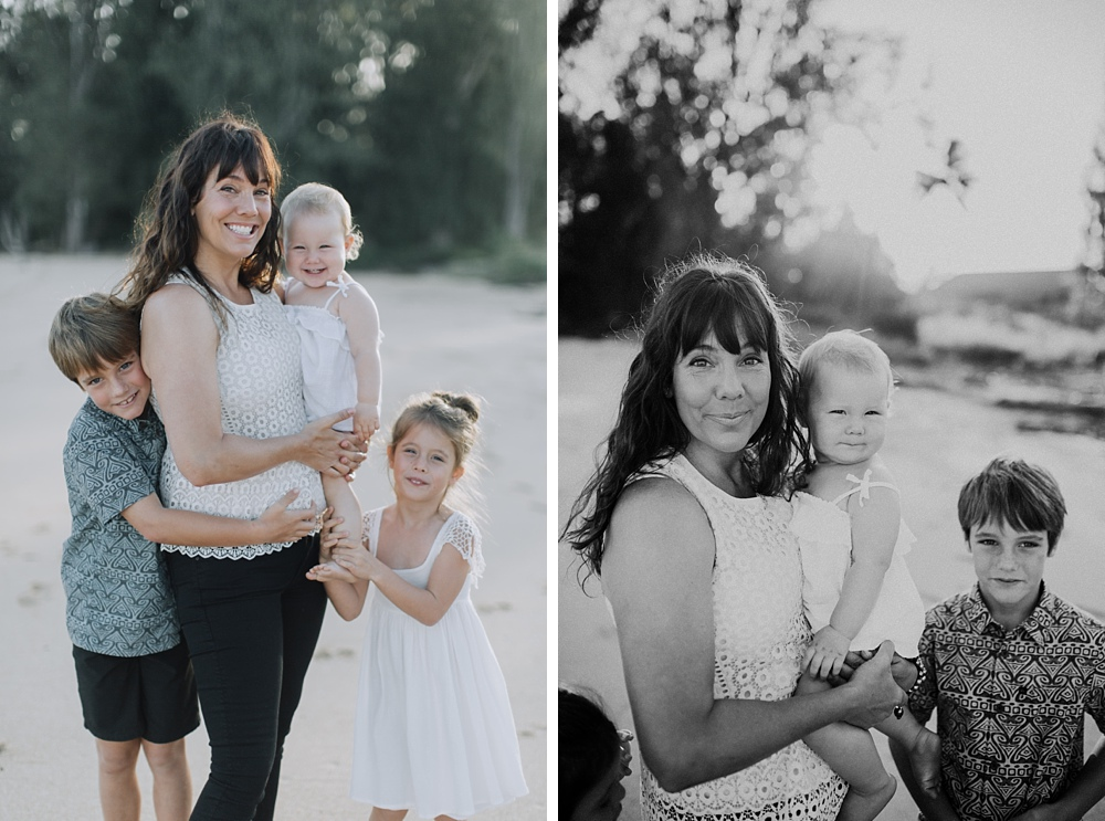 Beautiful mom with children during their maui family photo session at Baldwin Beach.