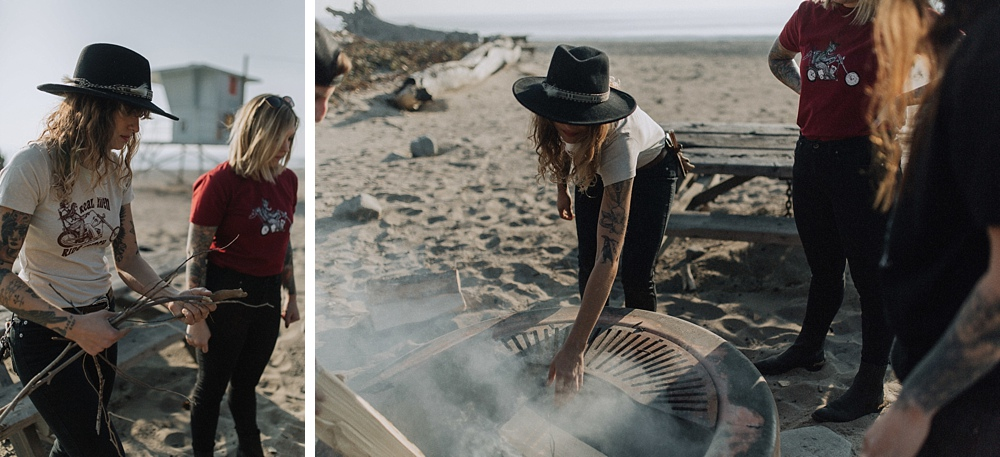 Women making a fire in Malibu at the beach.