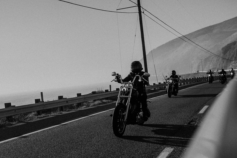 women motorcyclist on pacific coast highway